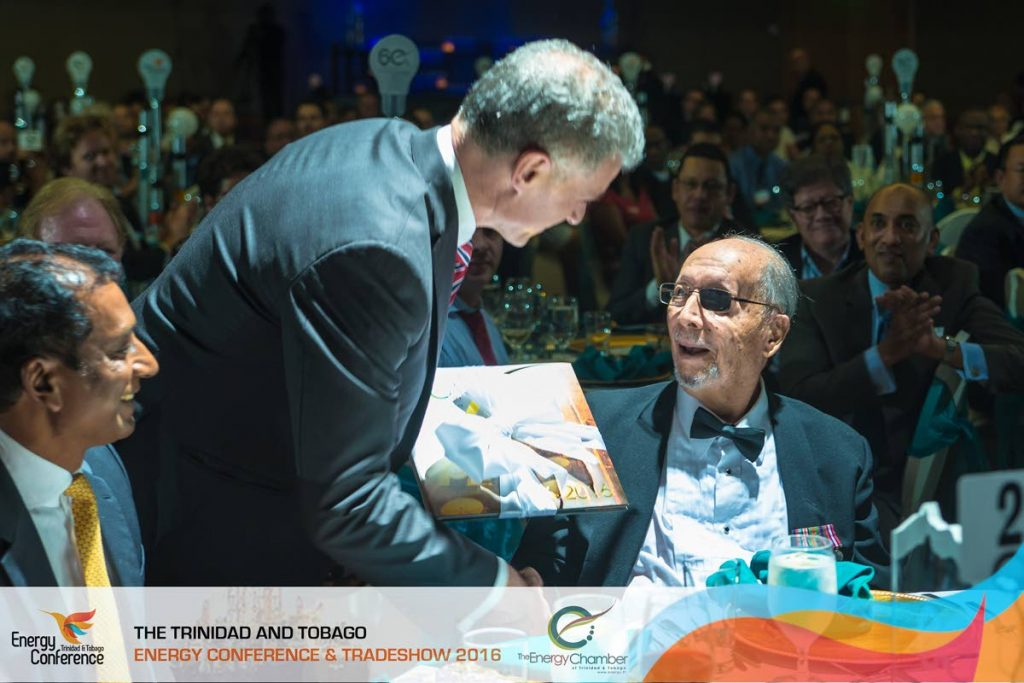 Energy Chamber CEO Energy Chamber CEO Dr Thackwray Driver presents an award to energy visionary Robert Montano during the chamber's energy conference and trade show in 2016.  - Media Mill Limited/Energy Chamber