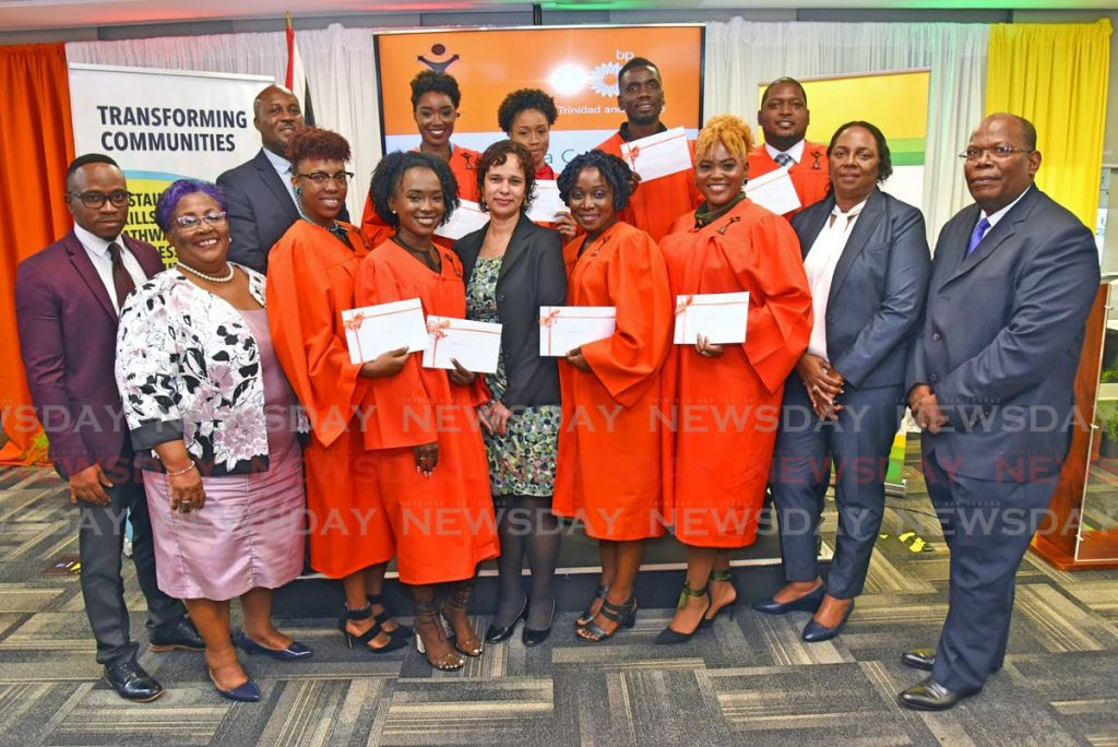 BEAMING: BPTT and YTEPP representatives celebrate with eight young business people who won awards of $20,000 each for top performance in an entrepreneurial development training programme. Front row (from left) are Jesse Moss, vice chairman, YTEPP; Thora Best, chairman, YTEPP; Jolie Francis (fifth from left), communications & external affairs, BPTT; Ronda Francis (second from right), corporate responsibility manager, BPTT; Christo Cave, director, YTEPP. Back row (left) is Nigel Parris, CEO, YTEPP. -