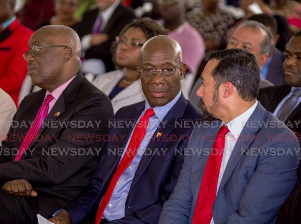 Prime Minister Dr Keith Rowley, centre, chats with National Security Minister Stuart Young, right, during the opening of the Roxborough Police Station on Friday. At left is Chief Secretary Kelvin Charles. PHOTO BY DAVID REID - DAVID REID