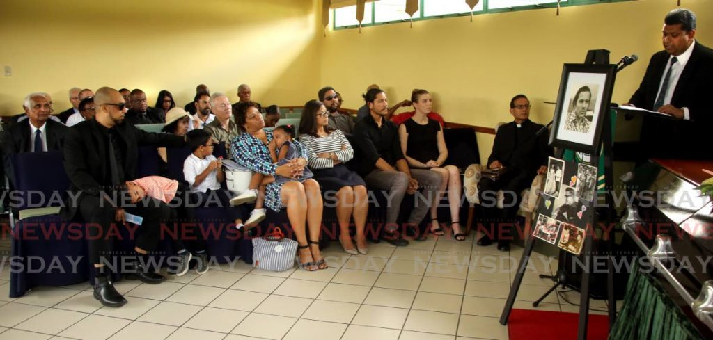 Former energy minister Kevin Ramnarine (right) speaking at the funeral service of energy journalist, David Renwick at Belgroves Memorial Chapel, Orange Grove Road, Trincity. PHOTO SUREASH CHOLAI -