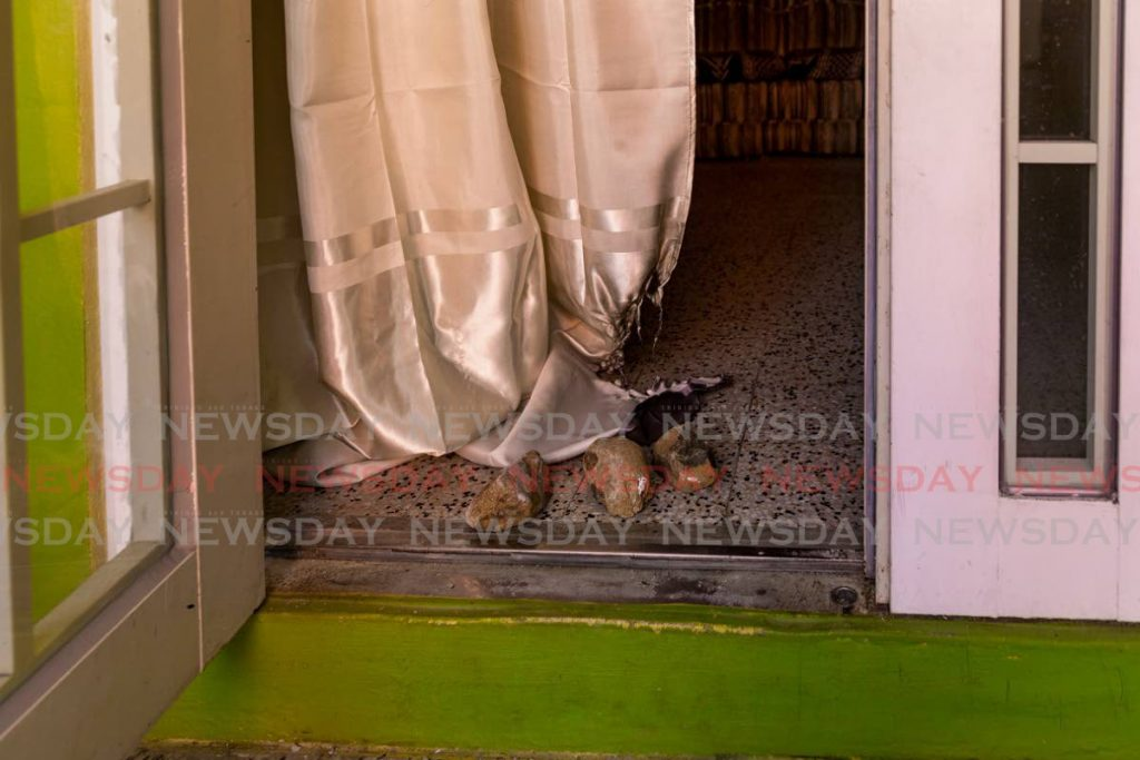 A burnt curtain at the home of contractor Mervyn Graham in Plymouth Road where a suspect allegedly committed arson last Friday.  - DAVID REID