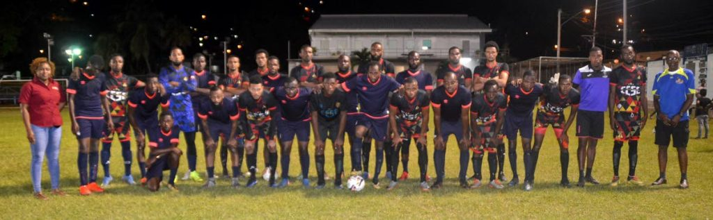 Players of Caution FC of Mayaro and Big Yard of Carenage share this special moment at the inaugural goodwill football match between the knock-out champions of the BPTT-sponsored community football league in the respective communities. -