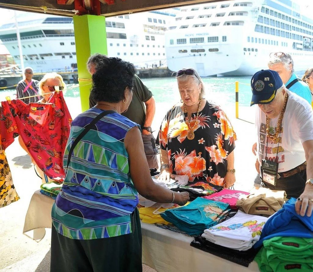 Tourists from the Costa Magica and Pacific Princess cruise ships  shop at the Port of Scarborough after docking on Sunday. PHOTO COURTESY DIVISION OF TOURISM  - DIVISION OF TOURISM