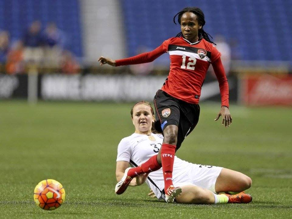 Trinidad and Tobago women football team midfielder Ahkeela Mollon (right) during a game against the United States recently. -