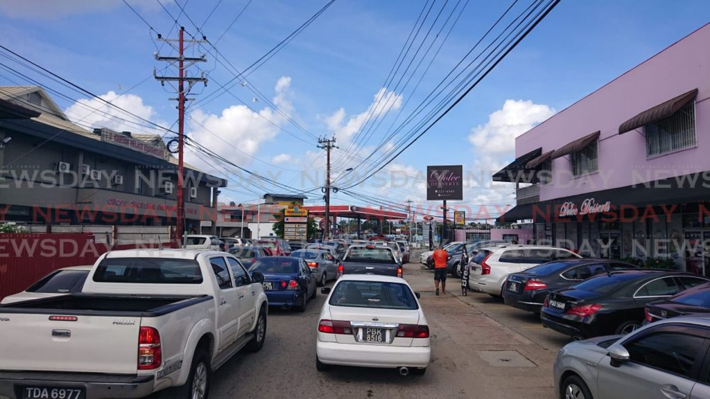 Vehicles in line at the NP gas station at Cross Crossing, San Fernando. Photo by Ria Chaitram.