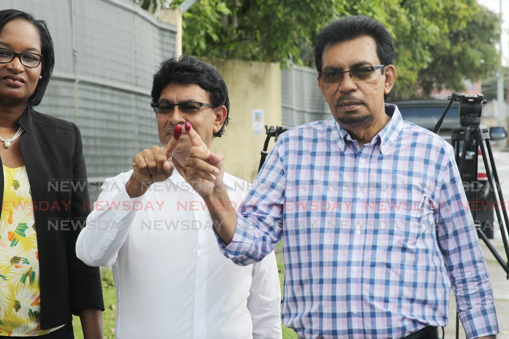 Local Government minister Kazim Hosein voted for his brother Ryaad Hosein whois contesting forthe PNM, Les Effort east .   Holder                            2-12-19