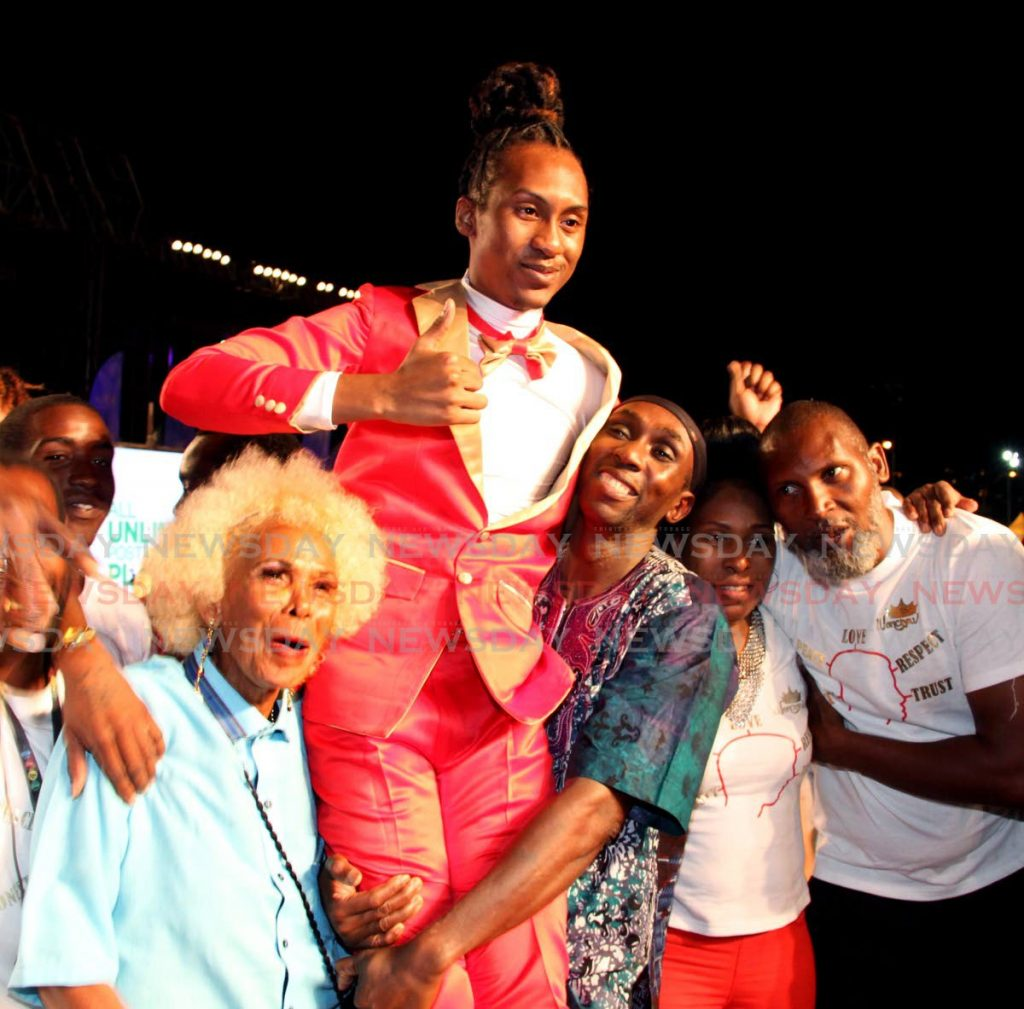 National Calypso Monarch 2019 Ronald London celebrates with his uncle, Brian London, right, and supporters after winning the crown at Queen's Park Savannah, Port of Spain on March 1, 2019.   - SUREASH CHOLAI