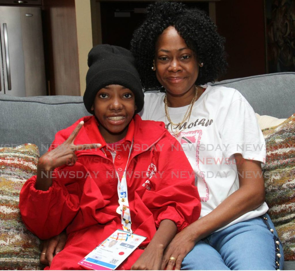 Special Olympics Athlete Shanice Baptiste, shows a peace sign, as she is welcomed upon her arrival at the VIP Lounge of the Piarco International Airport from Abu Dhabi, last year. - Angelo Marcelle