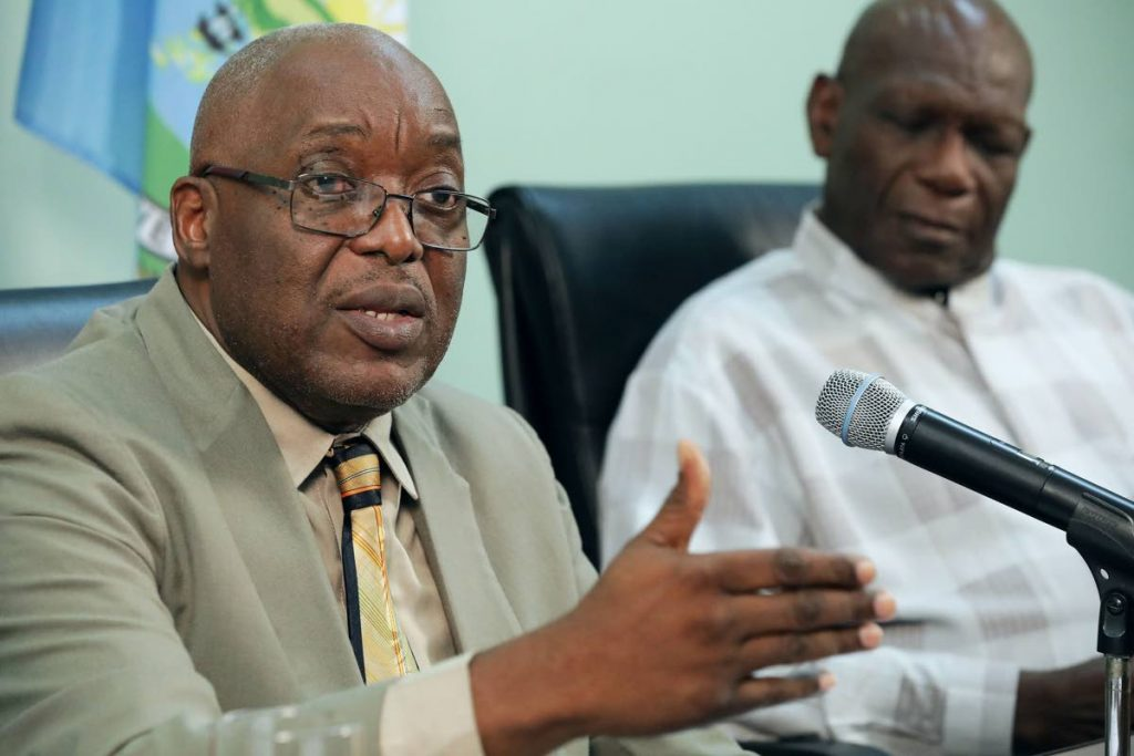 Chief Secretary Kelvin Charles, left, makes a point as Allan Richards, the head of the Airport Relocation Committee, looks on, during a press conference . - THA