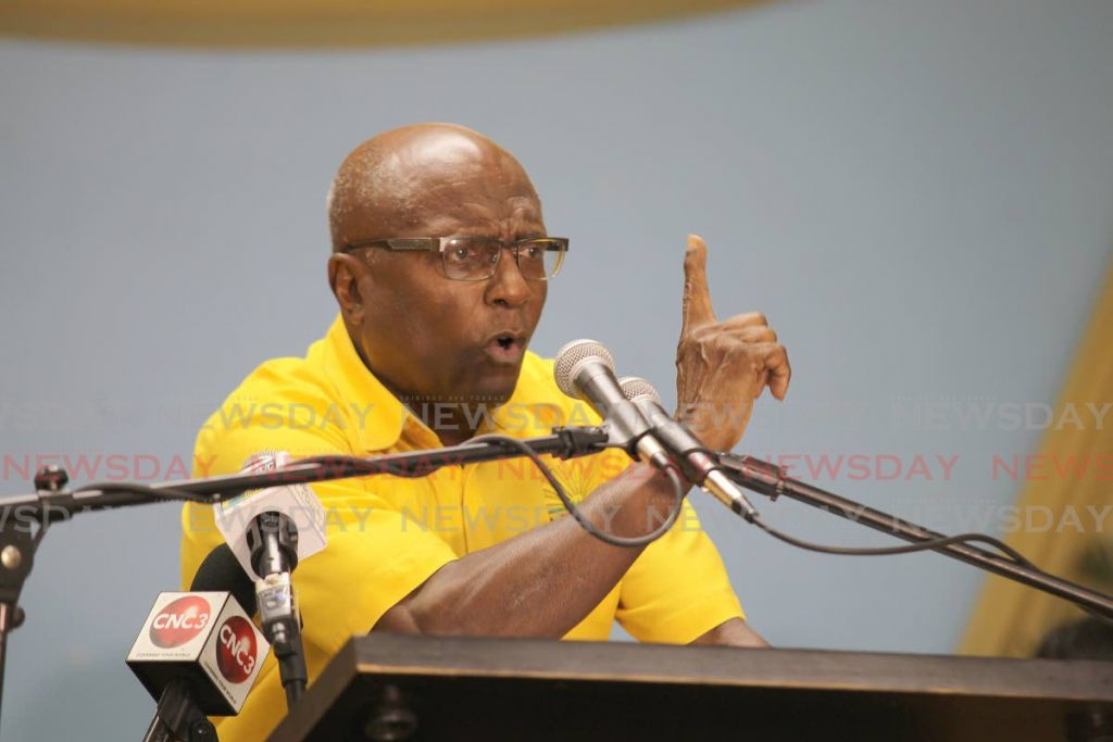 Naparima MP, Rodney Charles addressing supporters at UNC pavement meeting held at New Grant government school. - Lincoln Holder