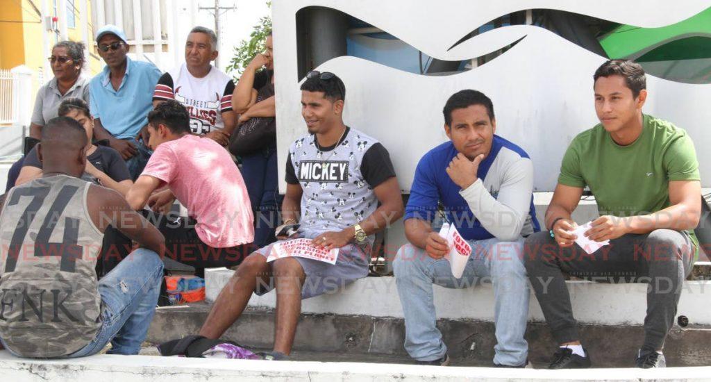 Venezuelans wait to be registered in San Fernando in June last year.  -