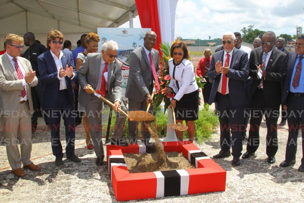 In this September 4, 2019 photo, Health Minister Terrence Deyalsingh, Prime Minister Dr Keith Rowley and Toco/Sangre Grande MP Glenda Jennings-Smith tun the sod to start construction of the new Sangre Grande hospital at Ojoe Road, Sangre Grande. Other dignitaries include Udecott chairman Noel Garcia, Deputy House Speaker Esmond Forde, VAMED regional manager Gerhard Hoellinger and Karl Pilstl, Honorary Consul of Austria. - ROGER JACOB