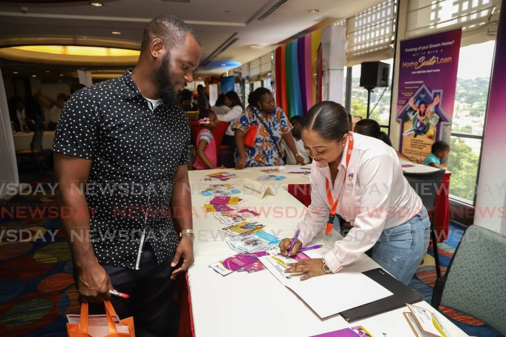 In this file photo, Venture Credit Union loans officer Whitney Applewhite answers questions from an attendee of the Housing 101 Expo held by the Ministry of Housing at the Trinidad Hilton in October 2019. One of the things Trinis wish for in 2020 is a home. - Jeff K Mayers