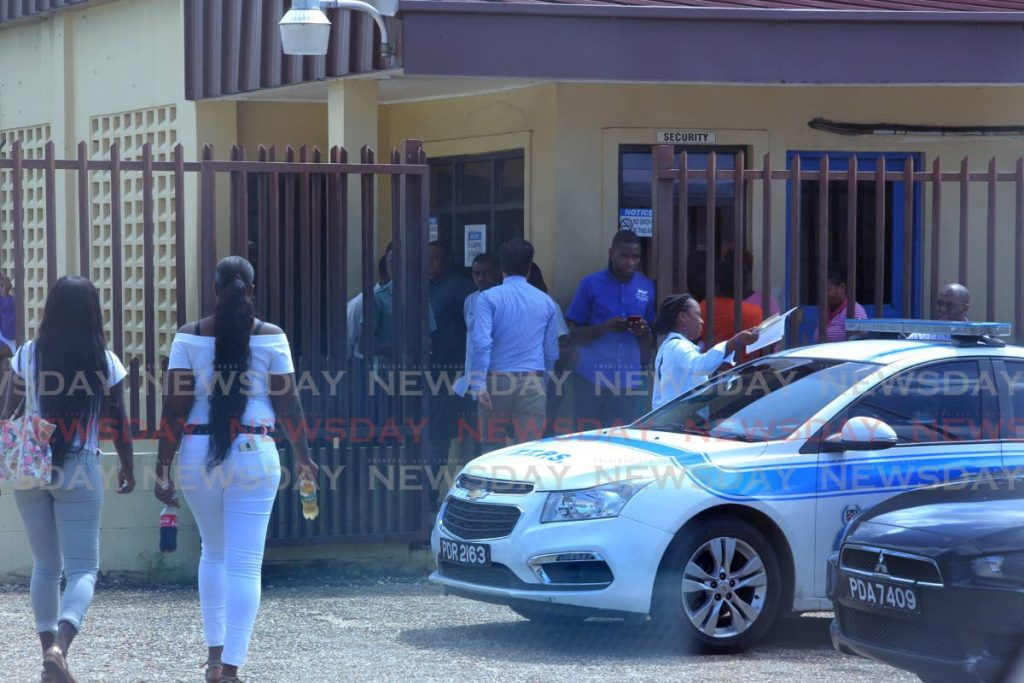 In this October 21, 2019 file photo relatives of homicide victims gather at the Forensic Science Centre, St James. A pathologist has quit six months after being hired to work at the centre. - ROGER JACOB
