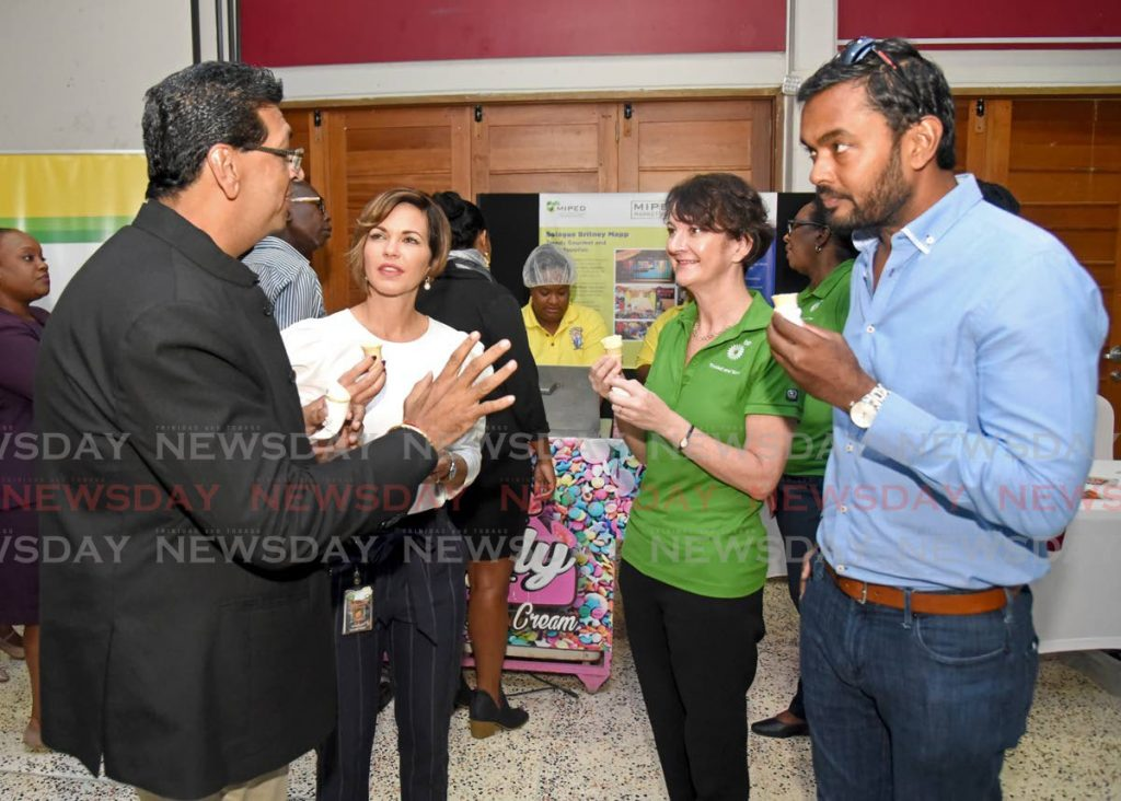 MP for Mayaro Rushton Paray, left, with BPTT's Giselle Thompson, Claire Fitzpatrick and Imran Mohammed.  -