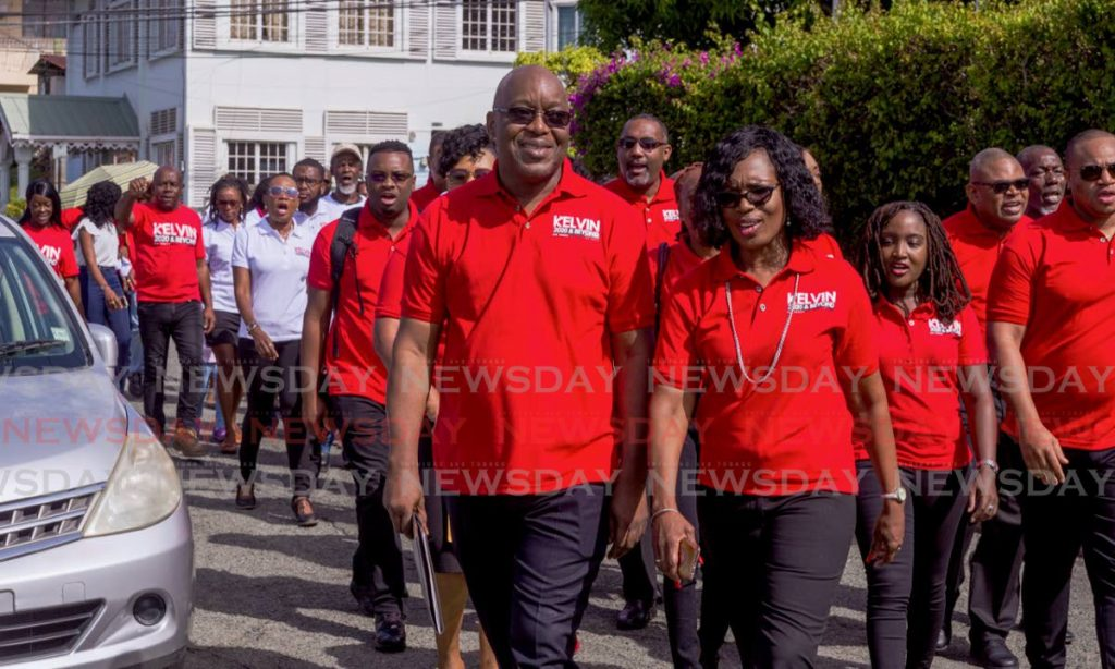 Chief Secretary and PNM Tobago Council political leader Kelvin Charles walks with his wife, Catherine.   - DAVID REID