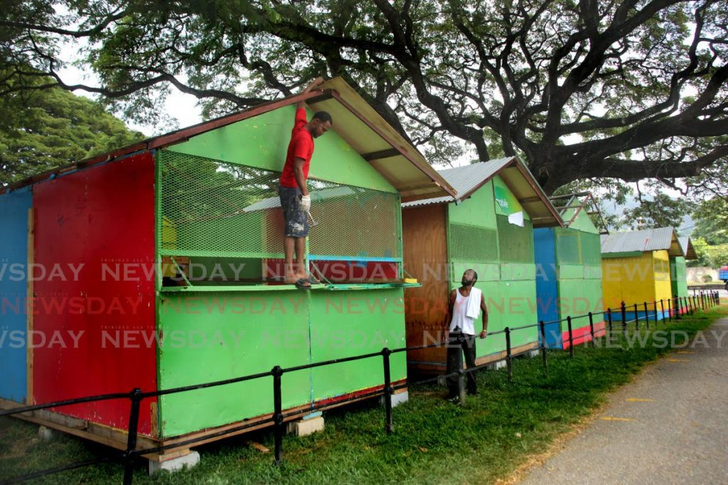 Workmen put finishing touches on booths at Queen's Park Savannah, Port of Spain which will be available for vendors for Carnival.  - Sureash Cholai