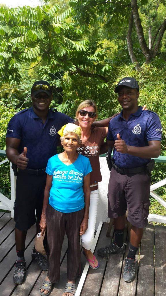 Teija De Silva, back centre, is all smiles at the Tobago Cocoa Estate.  -
