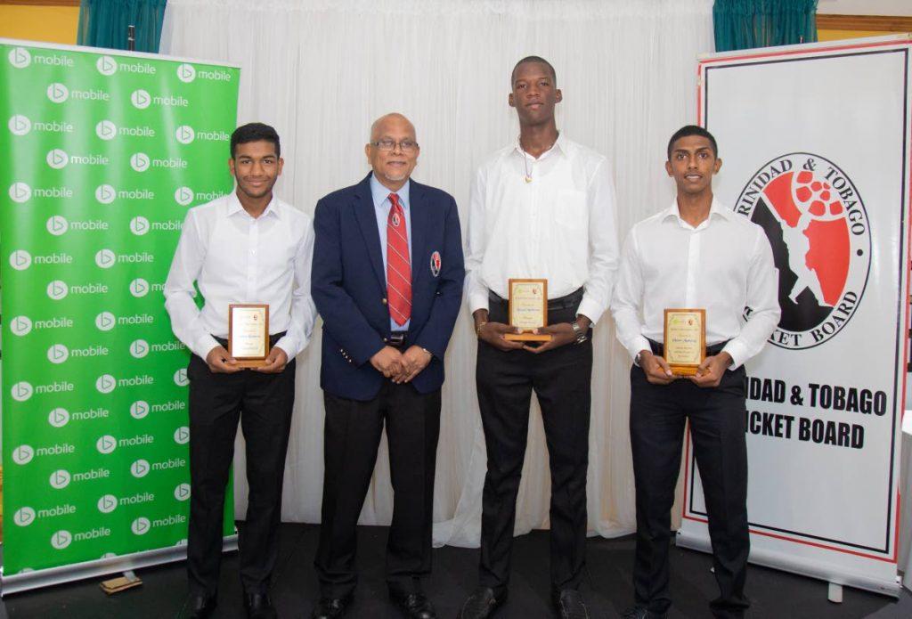 President of the TT Cricket Board Azim Bassarath, second from left, with the three outstanding 2019 TTCB/Bmobile Cricket Academy graduates, from left, Andrew Rambaran, Lemuel Matthews and Vanir Maharaj. - TTCB