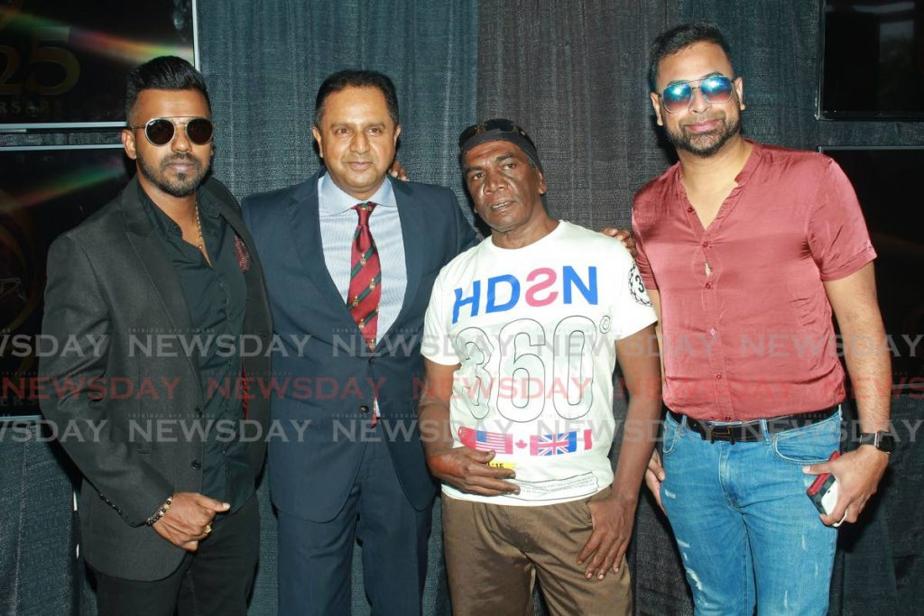 One of the reigning Chutney Soca monarchs Nishard Mayhroo, from left, Southex CEO George Singh, artistes Kenneth Salick and Ravi B, at the launch of the 2020 Chutney Soca Monarch competition at Paprika Bistro, Gulf City Mall, La Romaine on Friday.  - CHEQUANA WHEELER