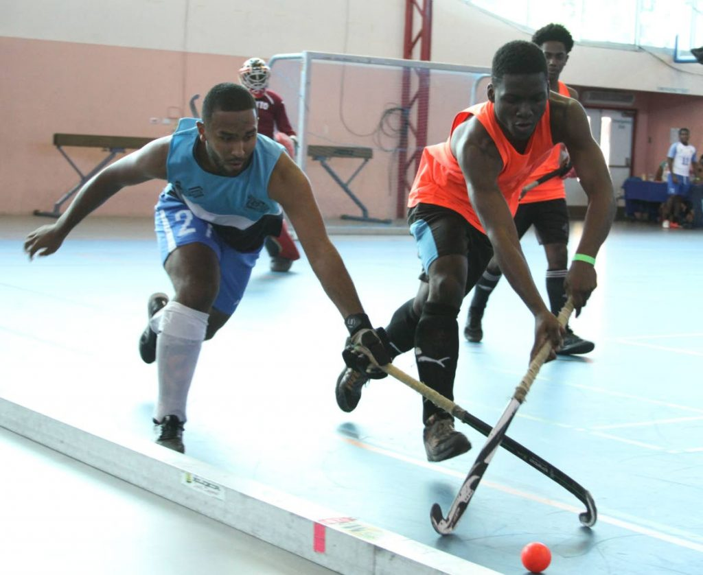 Jordon Reynos of Police, left,  battles Coker David of Paragon in a recent tournament  at UWI-SPEC, St Augustine. PHOTO BY ANGELO MARCELLE - Angelo Marcelle