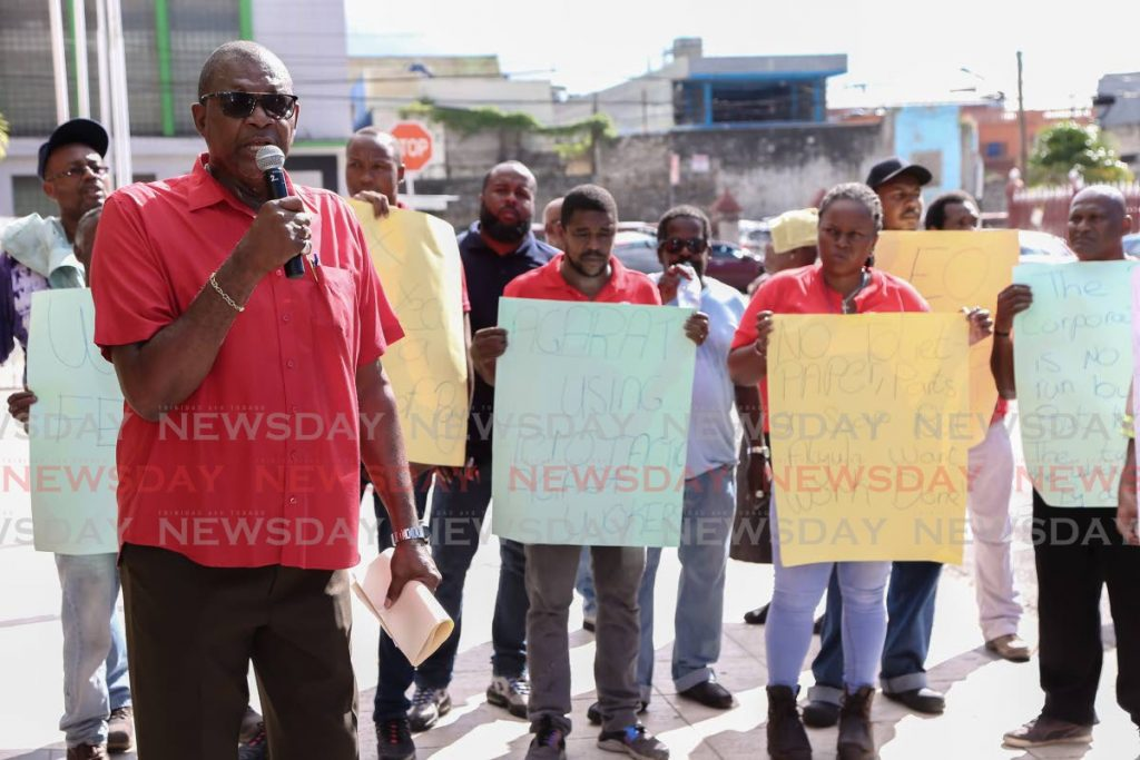 President of the Amalgamated Workers Union, Michael Prentice, leads workers of the Port of Spain City Corporation in a protest outside City Hall in Port of Spain on Monday.   - Jeff Mayers