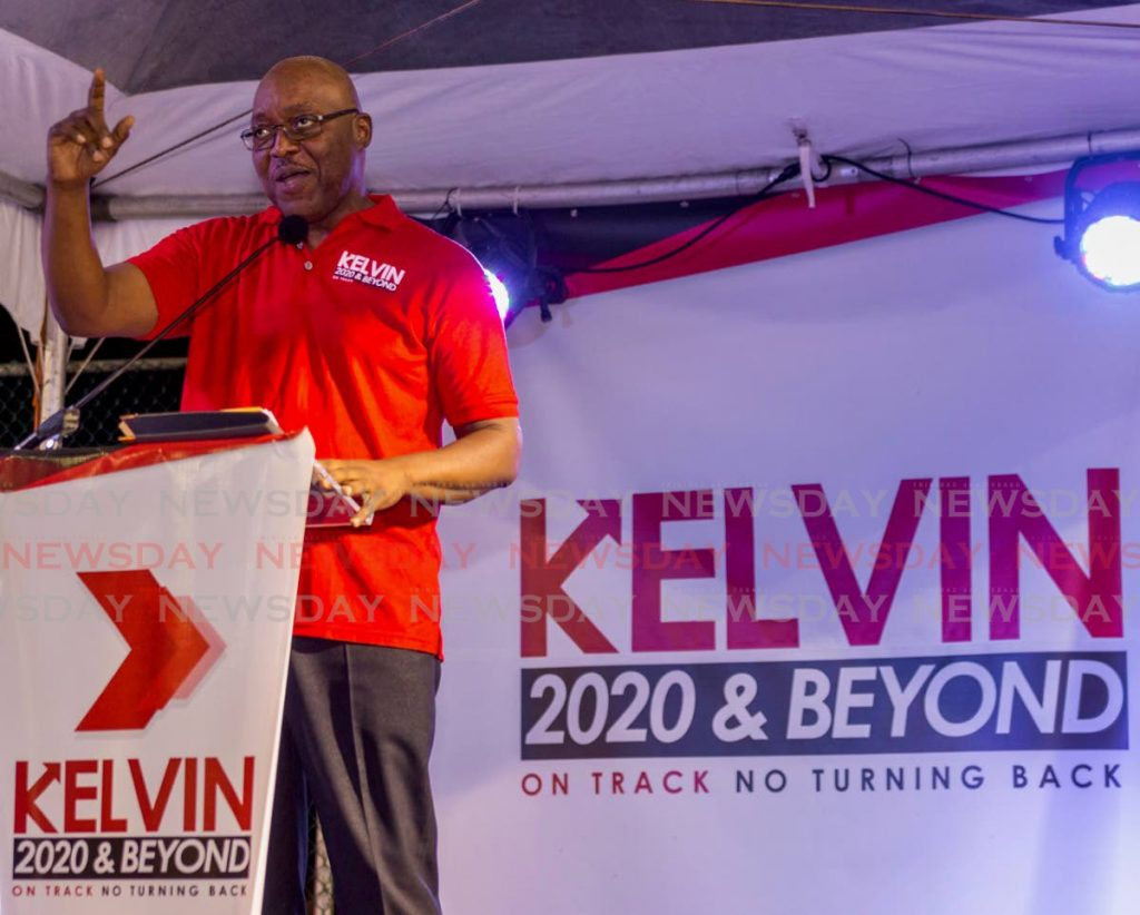 PNM Tobago leader Kelvin Charles speaks to supporters at the launch of his re-election campaign on Sunday at Black Rock Hard Court.   - DAVID REID