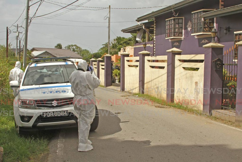 Crime scene investigators at  Jebodsingh Street, South Oropouch, home of Gabriella Du Barry, who was killed on Thursday morning. - Marvin Hamilton