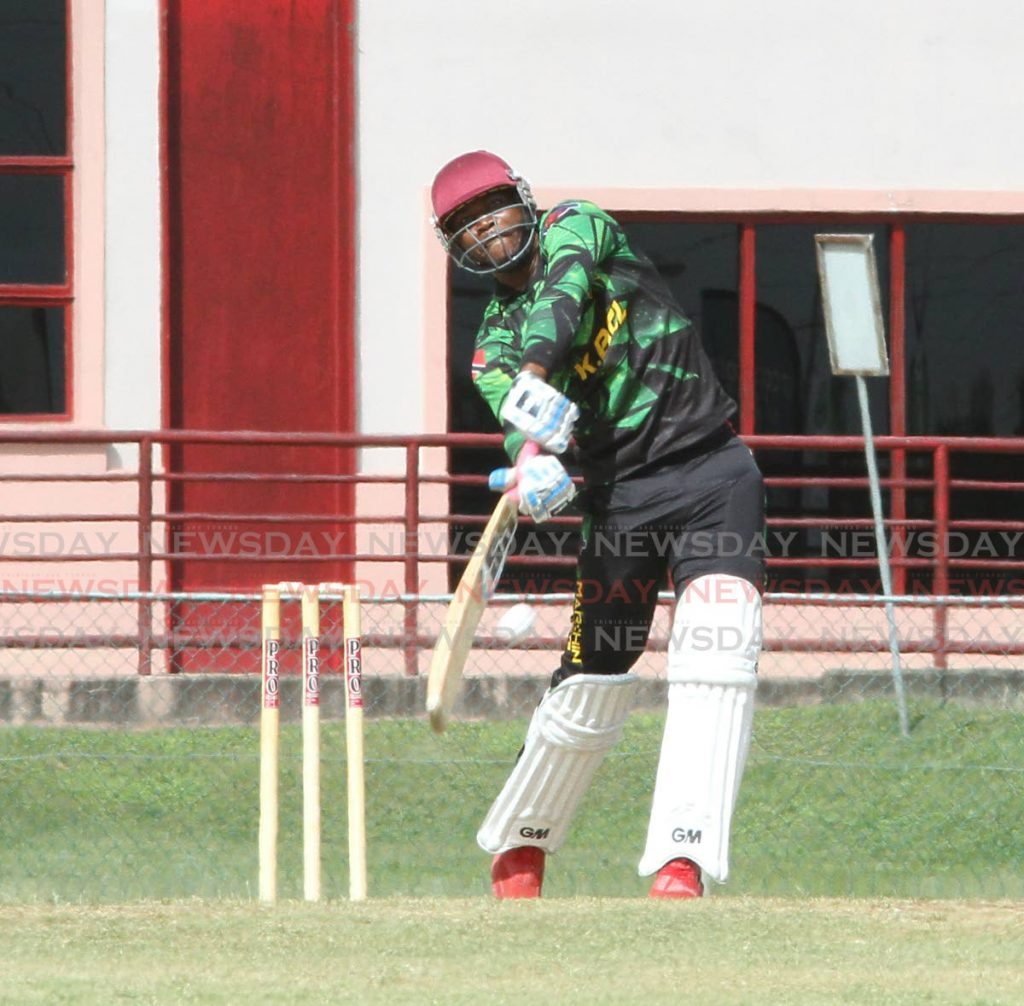 Teshawn Castro, of Marchin Patriots International, hits a big shot in his team's match against UWI Cricket Club, at the UWI-Unicom T20 tournament in St Augustine on Thursday. PHOTO BY ANGELO MARCELLE - Angelo Marcelle