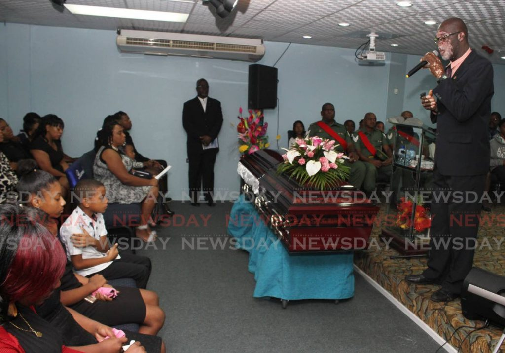 FOR MY WIFE: Lyndon Patterson sings at the funeral for his wife Lystra Hernandez-Patterson at the Covenant House of Praise, Henry Street, Port of Spain on Friday.  PHOTO BY ANGELO M MARCELLE - ANGELO_MARCELLE