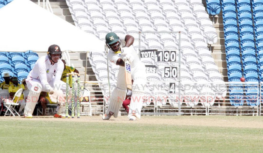 Rovman Powell, of Jamaica Scorpions, looks to play a shot against the TT Red Force, on Saturday, during the CWI Four-Day Regional tournament, at Brian Lara Cricket Academy, Tarouba. The match ended in a draw,on Sunday. - Vashti Singh