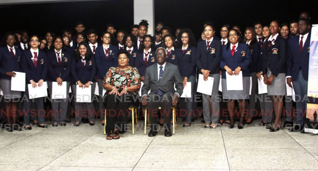 President Paula-Mae Weekes, centre left, and Retired Commander Anthony Franklin, chairman of the local President's Award Programme, pose with recipients of the award at the Duke of Edinburgh's International Award ceremony on San Fernando Hill on Saturday. - Vashti Singh