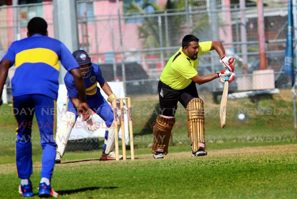 In this photo taken on Jan 11, East Zone Tigers batsman Ravindra Singh bats in the UWI-UNICOM Twenty20 match, against Aranquez SC, at the Sir Frank Worrell Grounds, St Augustine. - SUREASH CHOLAI