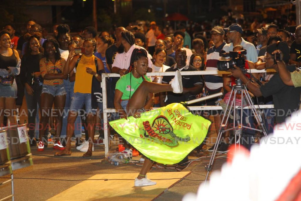 The Flag-Girl from Tobago Pan-Thers wows onlookers at the NLCB Panorama small band semi-finals on Saturday at Victoria Square, Port of Spain.  - ROGER JACOB