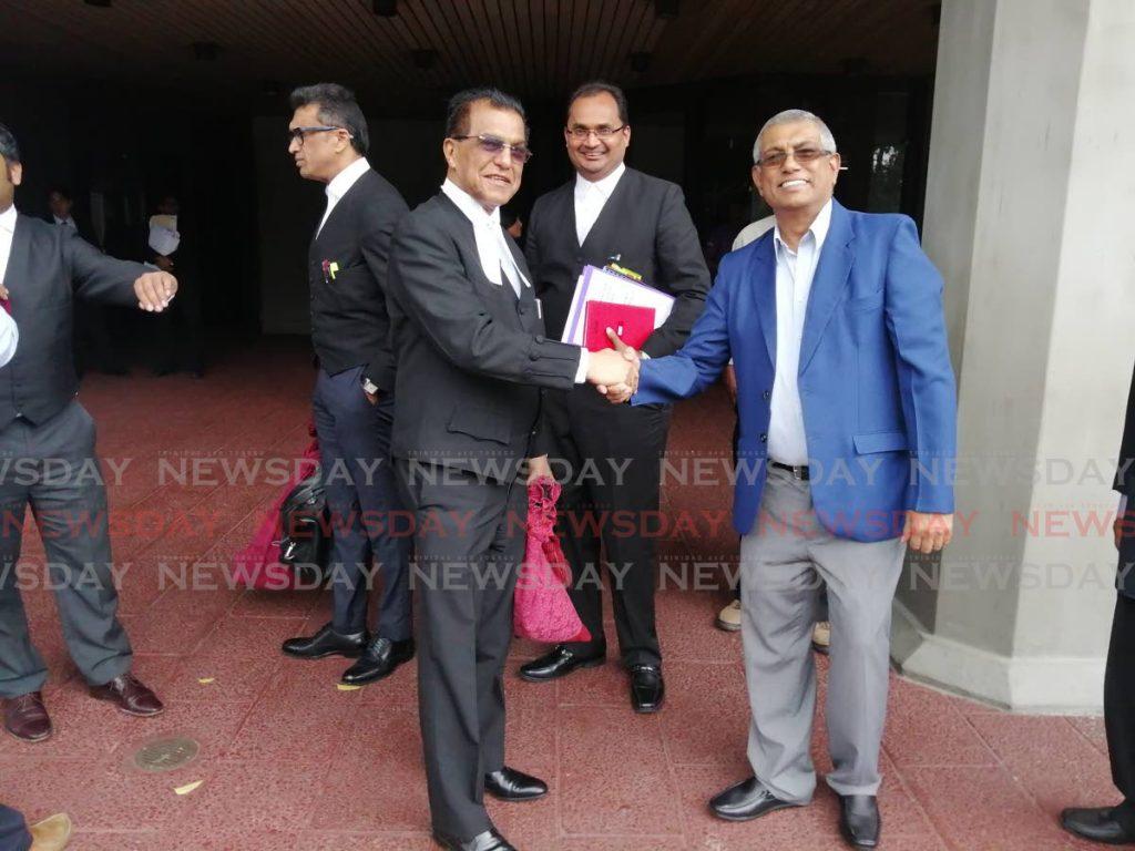 Senior counsel Ramesh Lawrence Maharaj is congratulated by Vijay Maharaj, son of late secretary general of the Sanatan Dharma Maha Sabha, Satnarayan Maharaj.   - KEINO SWAMBER
