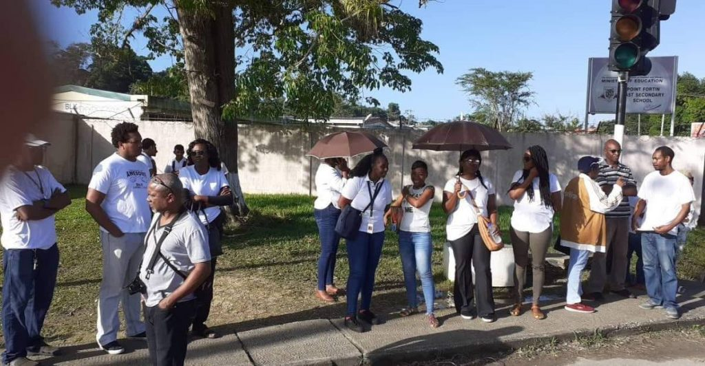 Parents and students protest outside the Point Fortin  East secondary school.  -