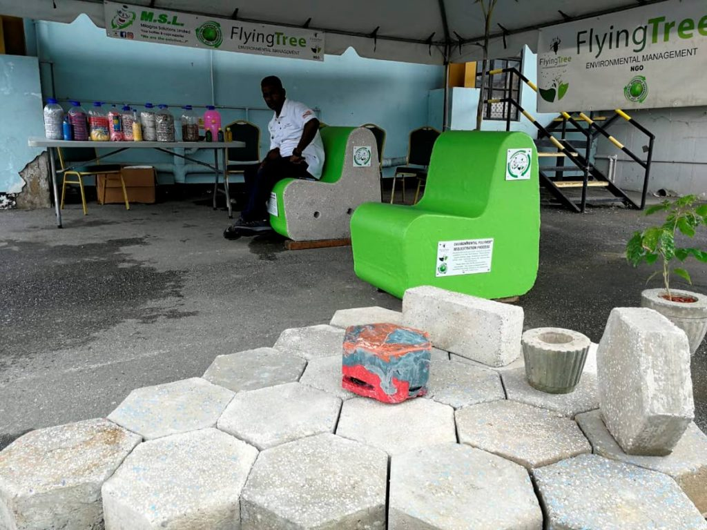Benches, plant pots and pavers made from recycled plastics on display at a Flying Tree Environmental Management booth during a 2019 environmental event.  -