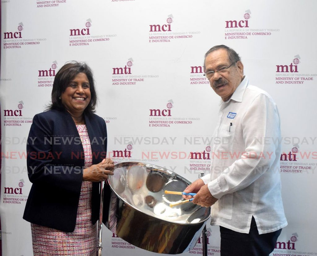 Minister of Trade and Industry Paula-Gopee-Scoon, shares a light moment with MIC Institute of Technology Professor Clement Imbert at a press conference held at the Trade Ministry's offices at Nicholas Towers, Port of Spain on Tuesday morning. - Vidya Thurab