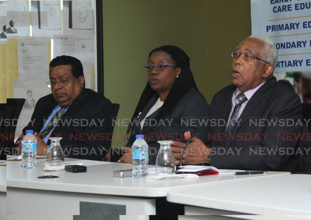 Minister of Education Anthony Garcia, right, speaks at a media conference at the Education Towers, St Vincent Street on Tuesday. Also in the photo are Chief Education Officer Harrilal Seecharan, left, and Permanent Secretary Lenor Baptiste-Simmons.  - Ayanna Kinsale