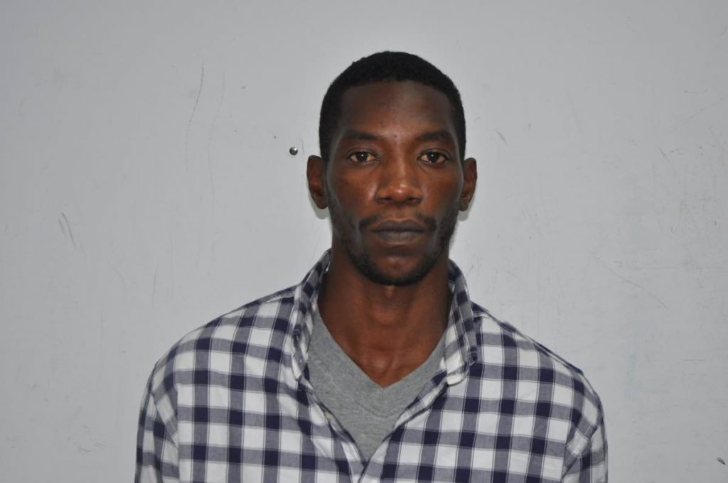 Nathaniel Ellis, 31, of Pinto Road, Arima, was charged with the murders of Polly-Ann Chuniesingh, her brother Damian Chuniesingh and their uncle Randy Chuniesingh. '   PHOTO COURTESY THE TTPS - Shane Superville