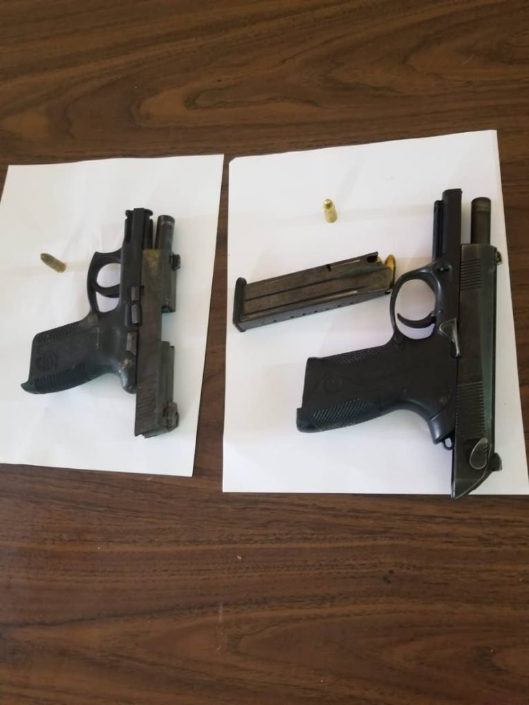 Two guns were seized and two teens held by Tunapuna police on Tuesday morning.  PHOTO COURTESY TTPS - Shane Superville