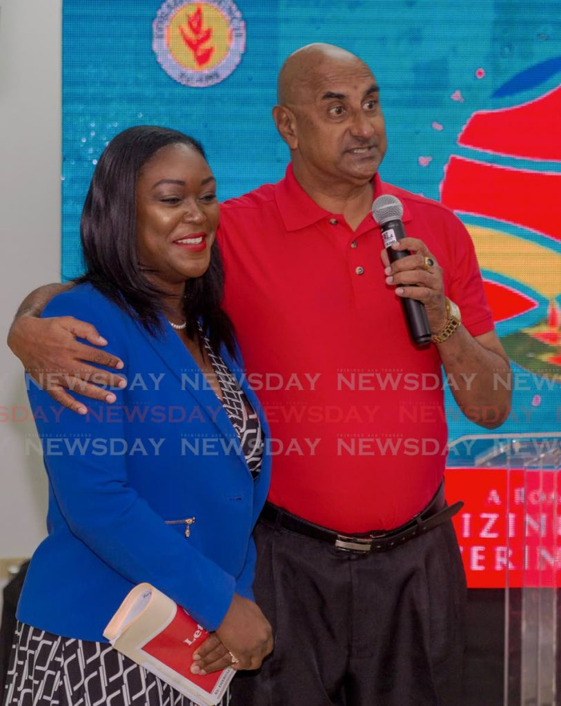 PNM leadership candidate Tracy Davidson-Celestine, left, is hugged by calypsonian Eric Powder after he performed at her campaign launch last Wednesday at the Buccoo Integrated Facility. PHOTO BY DAVID REID  - DAVID REID