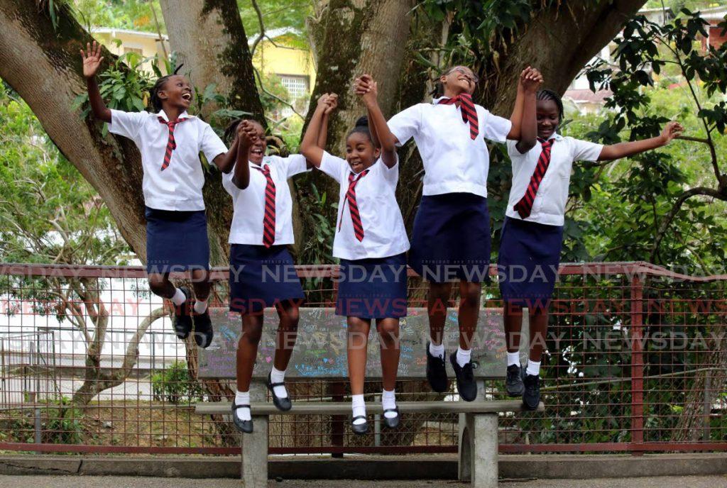 Yejude Brizan, from left, Janaeda Christmas, Kesi Joseph, Yja Holder and Feyi Oladiran share the joy of friendship as students of Bishop Anstey Junior School, St Ann's. PHOTO BY SUREASH CHOLAI  - Sureash Cholai