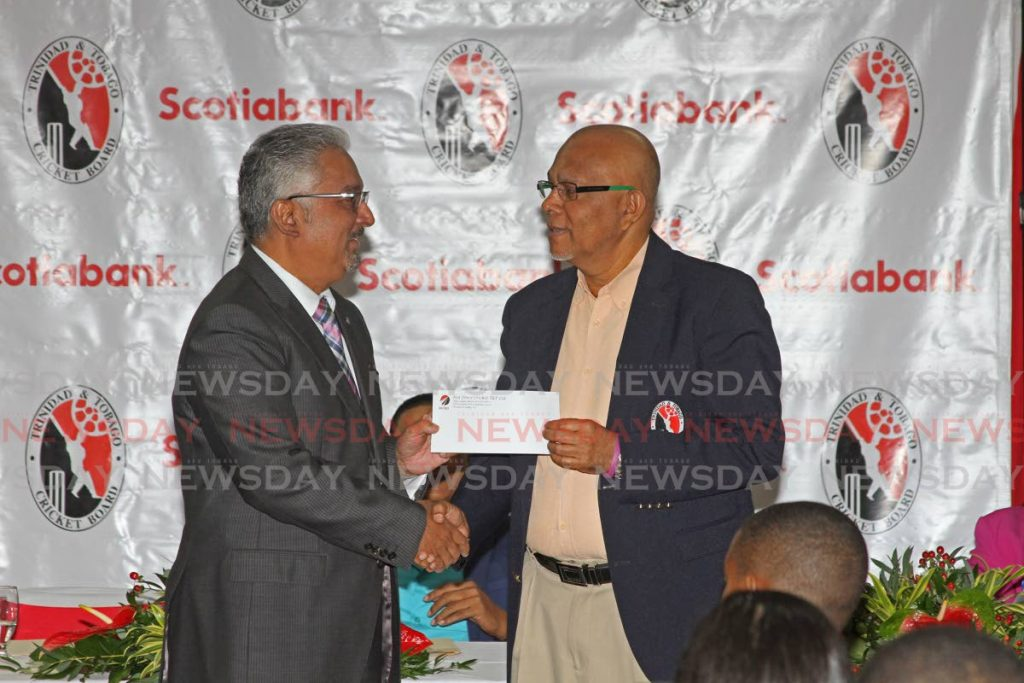 Scotiabank Limited's Retailing Banking and Small Business vice president, Savon Persad presents TT Cricket Board president, Azim Bassarath with a cheque at the launch of Scotiabank Nextgen Under 15 Zonal Tournament 2020, at the Alloy Lequay Administrative Centre, Couva on Wednesday morning. - Marvin Hamilton