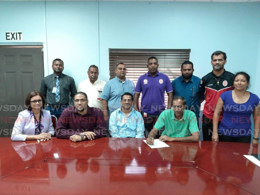 Officials of the Secondary Schools Cricket League and PowerGen renew their partnership. -