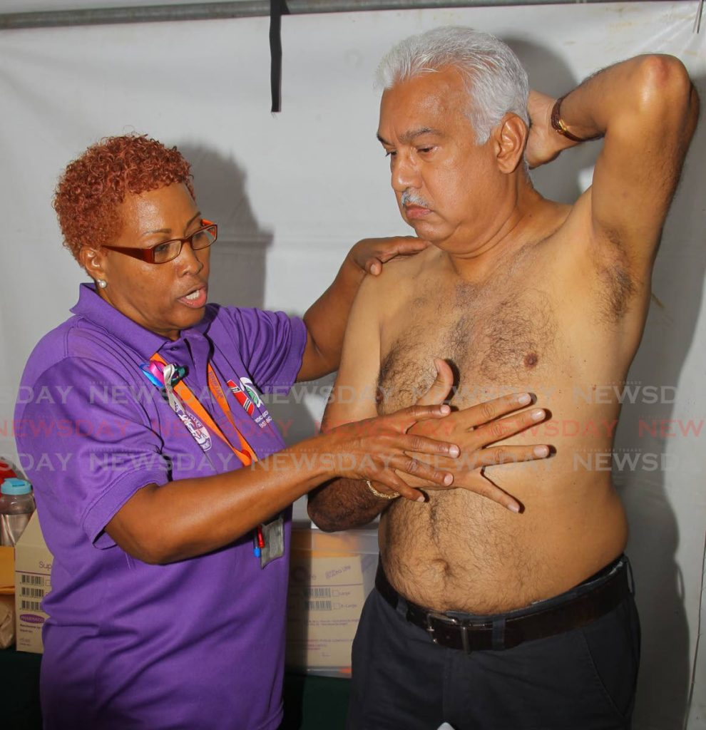 In this January 16 file photo Minister of Health Terrence Deyalsingh is examined by oncology pallative nurse Suzette Fernandez as the Eastern Regional Health Authority (ERHA) hosted a breast cancer awareness drive at the St Francis of Assisi RC Church, Sangre Grande, Wednesday. - ROGER JACOB