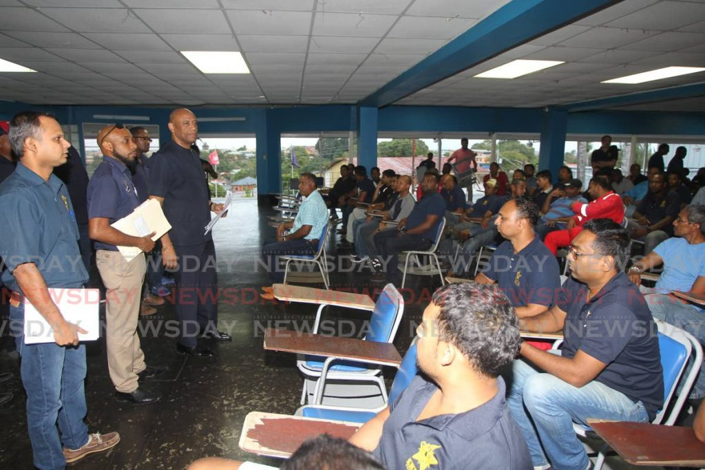 OWTU President Ancel Roget and other OWTU officials meet with Yara employees at Paramount Building, Circular Road, San Fernando, on Thursday. - LINCOLN HOLDER