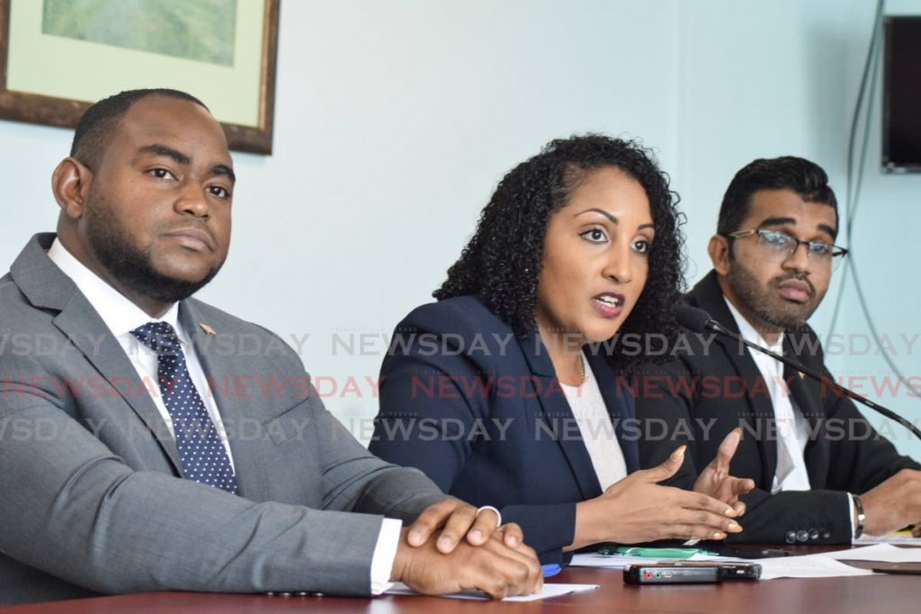 ANITA FIRES BACK: UNC PRO and senator, Anita Haynes, speaks at a press conference on Friday at the Opposition Leader's office in Port of Spain. At left is senator Sean Sobers and at right, senator Saddam Hosein.  - Vidya Thurab