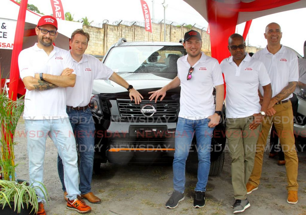 MEN IN GEAR: From left, Nissan sales manager Silvano Guerra; sales director, Olivier Rochard; drive team member, David Quiroga; Massy Motors VP, Aloysius Bereaux and Massy Motors Asst VP, Kyle Wynyard with the Nissan Frontier X Gear which was launched on Friday at Massy Motors, Morvant   - ROGER JACOB