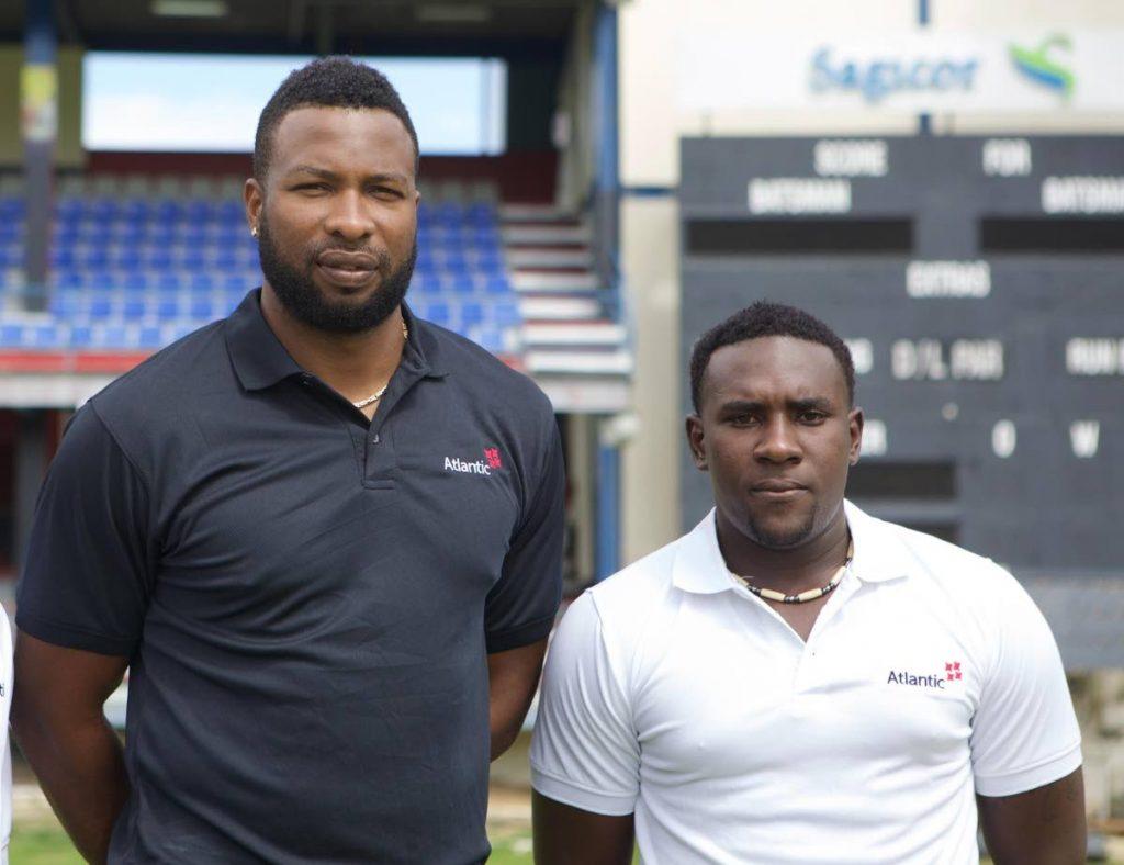 Atlantic sport ambassador Kieron Pollard, left, and Iraq Thomas who won a cricket scholarship in 2015.  -